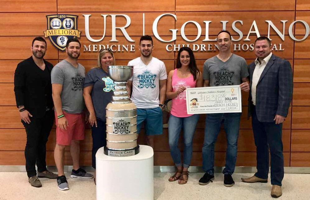 Beach Hockey Classic board presents check to Golisano Children's Hospital